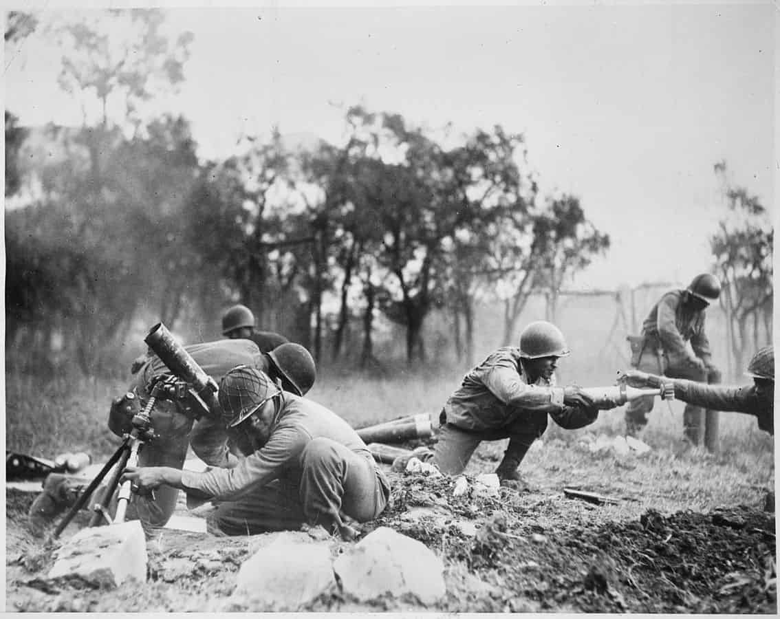1134px--Members_of_a_Negro_mortar_company_of_the_92nd_Division_pass_the_ammunition_and_heave_it_over_at_the_Germans_in_an_almos_-_NARA_-_535546