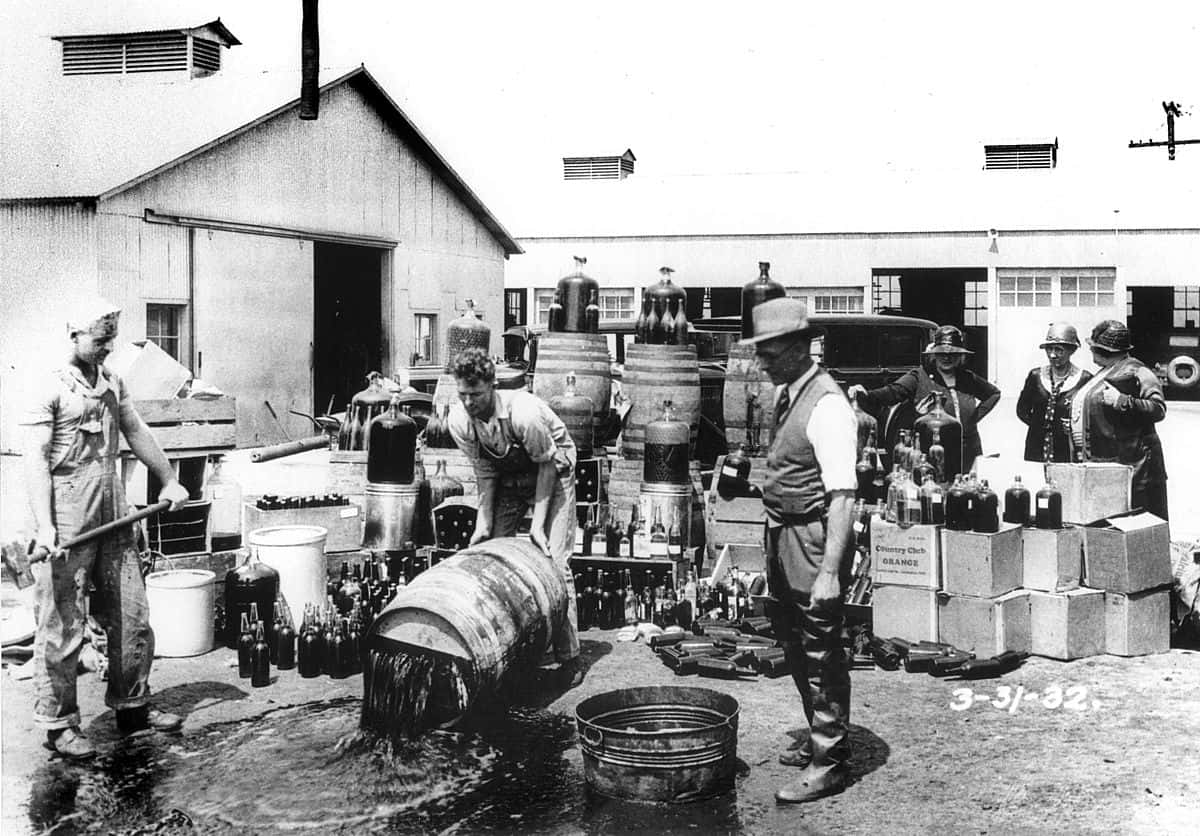 1200px-Orange_County_Sheriff's_deputies_dumping_illegal_booze,_Santa_Ana,_3-31-1932
