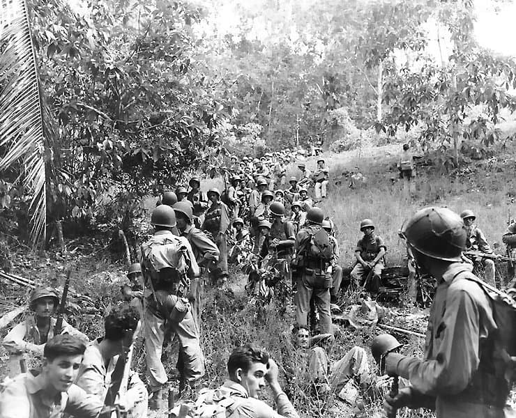 Marines_rest_in_the_field_on_Guadalcanal (1)