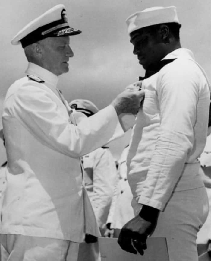 Chester W. Nimitz awards Doris Miller with the Navy Cross at the ceremony onboard USS Enterprise (CV-6) at Pearl Harbor, May 27, 1942.