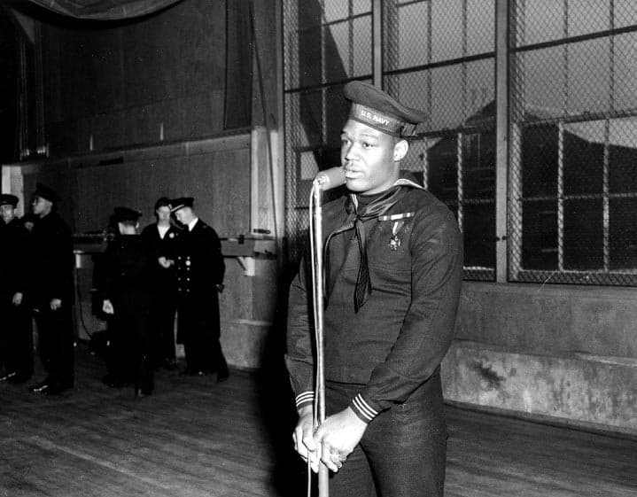 Doris Miller speaking at the Naval Station Great Lakes, January 7, 1943, wearing the Navy Cross.
