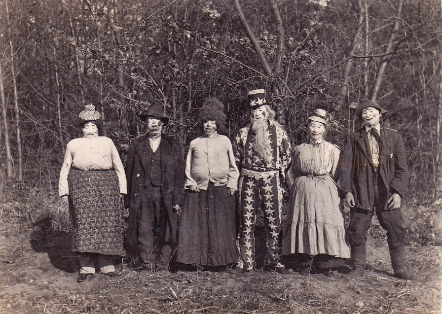 vintage portrait of a group in halloween costumes circa early 1900s